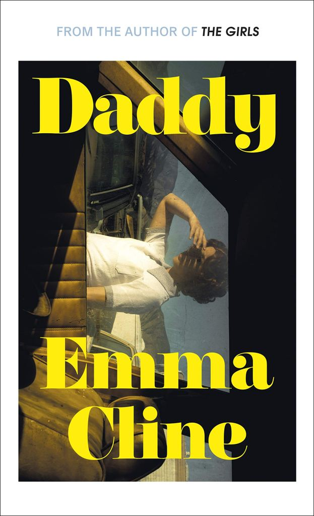 This image is the book cover of Daddy by Emma Cline. The background is a photo taken from inside a car, and there is a woman in a white top outside the car, and she is sheilding her eyes from the sun. The title and author are in yellow writing.