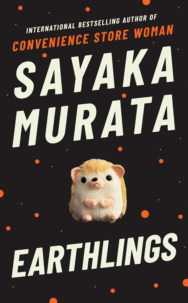 This book has a black background with orange dots. The title and author is in white on the front, which is Earthlings by Sayaka Murata. The cover also features a toy hamster.