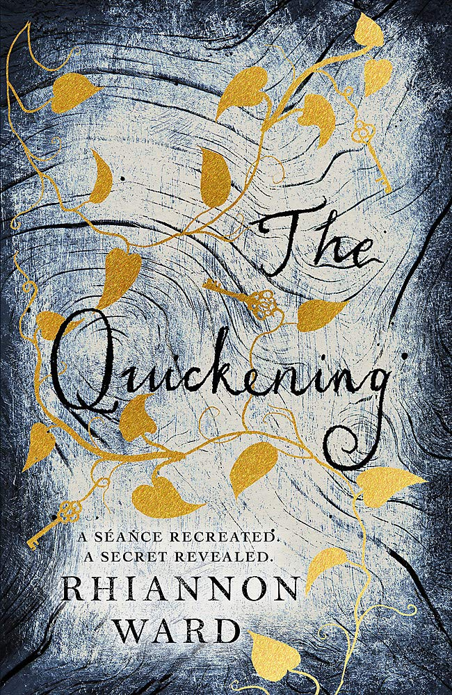 This image is the cover of the book The Quickening by Rhiannon Ward. The background looks like a close up of a grey, painted tree. It has gold painted ivy climbing up it, and occasionally an ivy leaf is replaced by a key. The title and author's name are in a dark blue/grey colour.